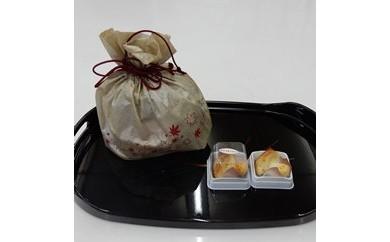 焼き菓子 銘菓・かぶちまつたけをシックな巾着袋に入れてお届け。全国菓子大博覧会で名誉総裁賞受賞!