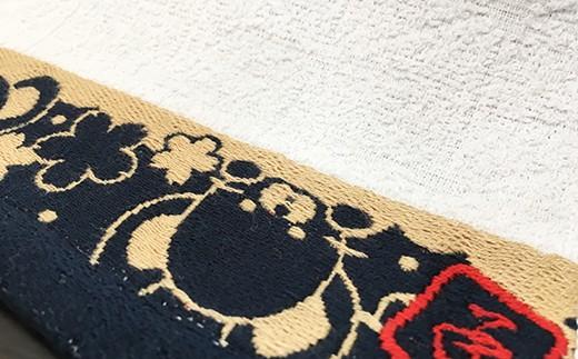 タオル部分は地模様入り。紺のフチ部分にはねずみの可愛いイラスト入り。